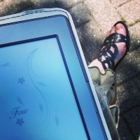Myself, reading Wind Chime Wedding on my Kindle!