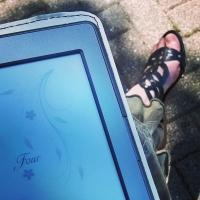 Myself, reading Wind Chime Wedding on my Kindle!