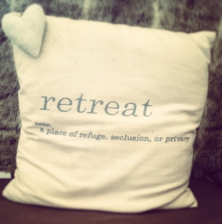 cushion with Retreat written on it on The Last Krystallos blog