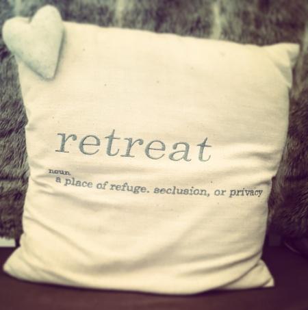 cushion with Retreat written on it on The Last Krystallos blog