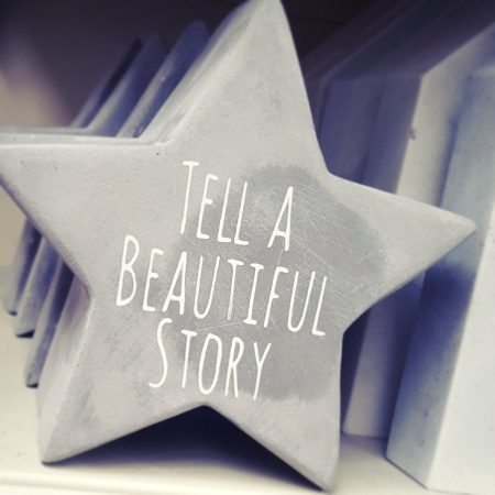 Star ornament with Tell a Beautiful Story written on it - The Last Krystallos