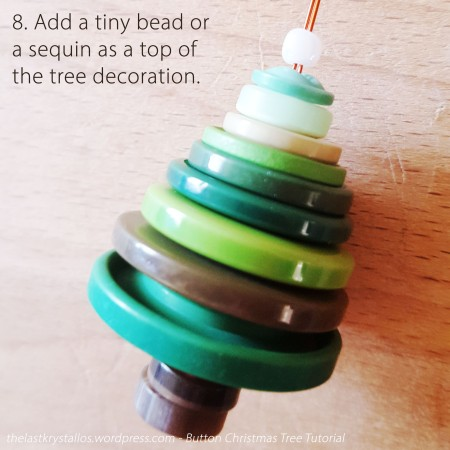 8. Add a tiny bead or a sequin as a top of the tree decoration.