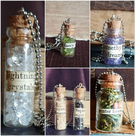 Photograph of gifts by Amaranth Alchemy on Etsy: Potion bottle necklaces - Lightning crystals with glass crystals, A Faery's Song with peridot gems, Amethyst Dreams with purple glitter, Ocean Dreams and Neptune's NIght-tide with sand, Winter Forests with moss and leaves.