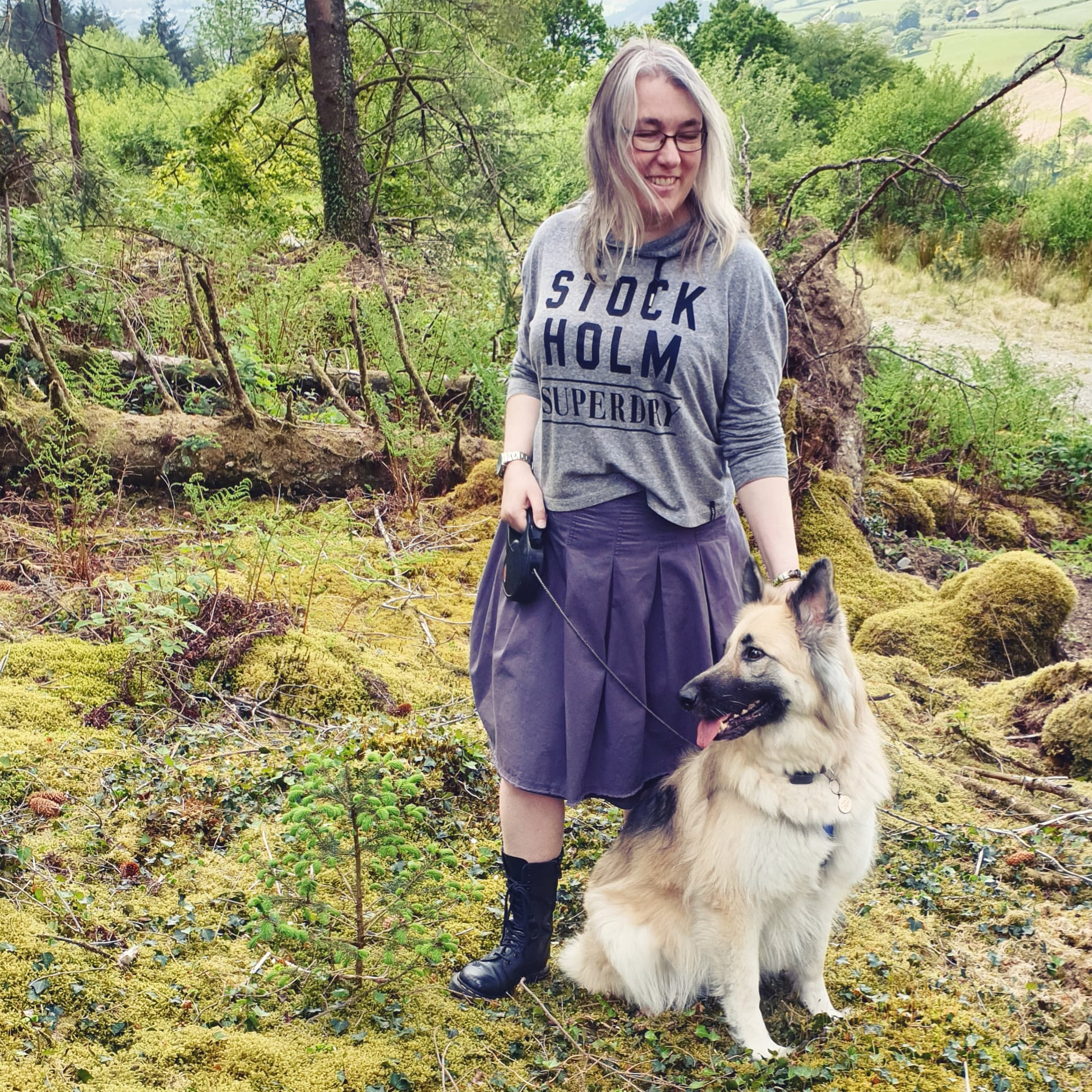 Lisa Shambrook in a mossy forest with Kira German Shepherd